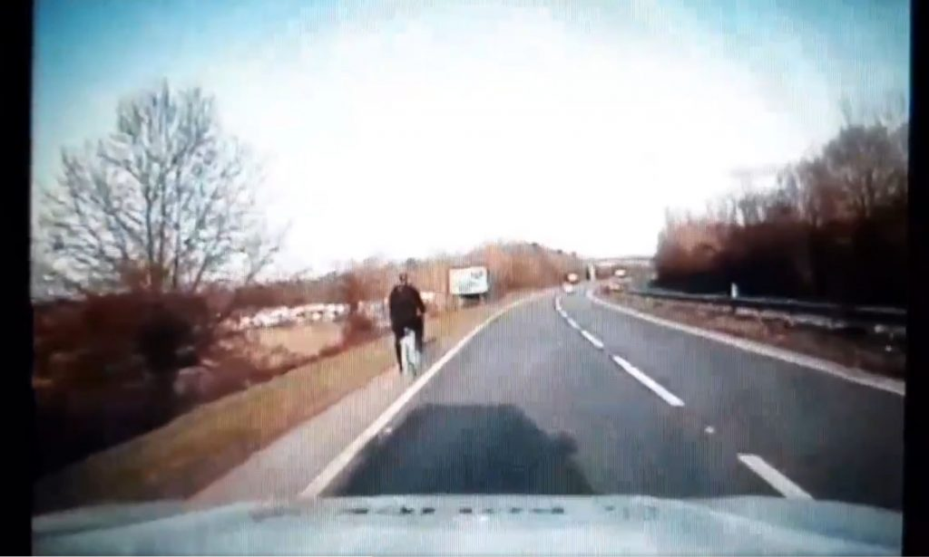 Watch the moment a Police officer rides a bicycle on the A14 after recovering it from lane 2