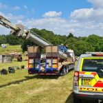 Lorry stopped by Police on A14 with mast hanging over the back by 7 metres